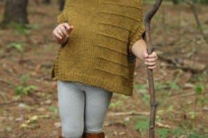 Los chalecos de niños tejidos a palillos al paso de la moda
