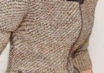 El cardigan tejido a dos agujas para la variedad femenina